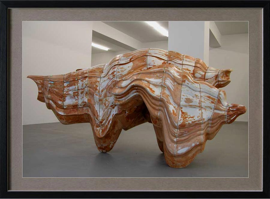 "Anthony Cragg (b. 1949 in Liverpool, England. Currently lives in West Germany). Caught Dreaming. 2006. Museum Beelden aan Zee, The Hague. The work is made out of Jesmonite and somehow resembles the body a rhinoceros. As Cragg puts it himself: it forms ""a volume of sequential profiles where the orientation of the profile remains the same but, instead of staying parallel to each other, the templates are at angles to one another and provide an impulse for the form to change direction""."